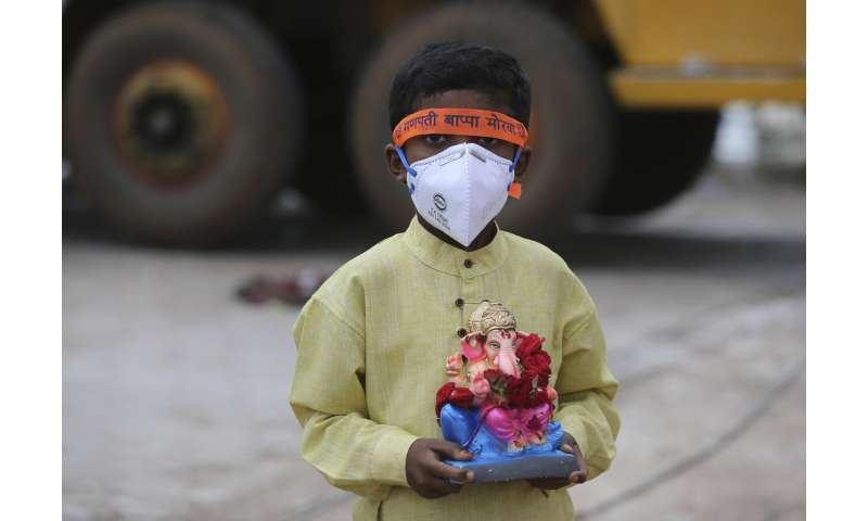 India eases virus restrictions as cases near 3.7 million