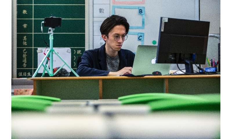 In Hong Kong, some teachers are offering students lessons online during the closure