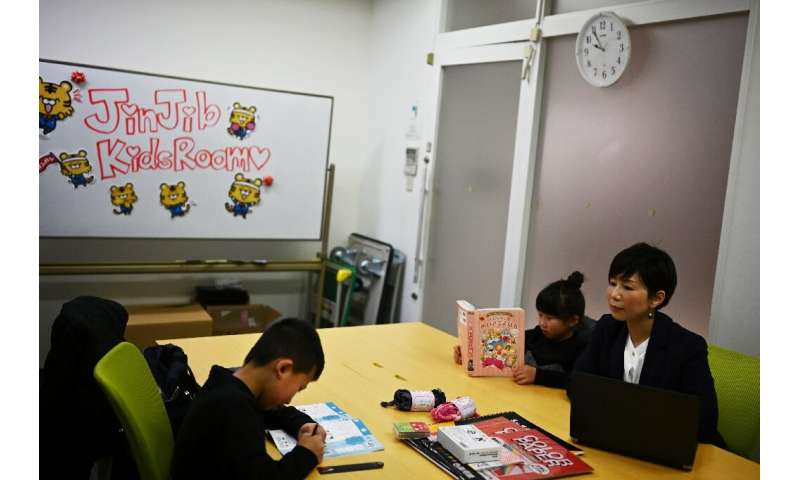 In Japan, some companies have allowed parents to bring children to work during school closures
