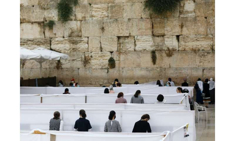 In Jerusalem, special measures have been put in place to ensure those praying at the Western Wall keep a safe distance from each