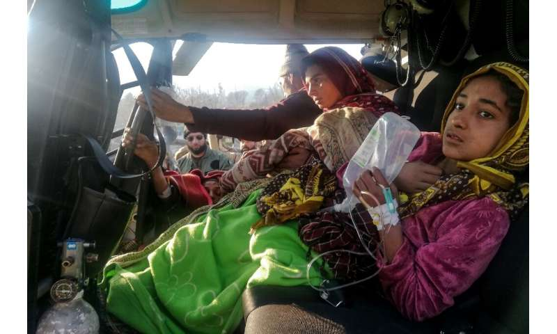 Injured avalanche victims arrive in an army helicopter in Muzaffarabad, the capital of Pakistan-administered Kashmir, following