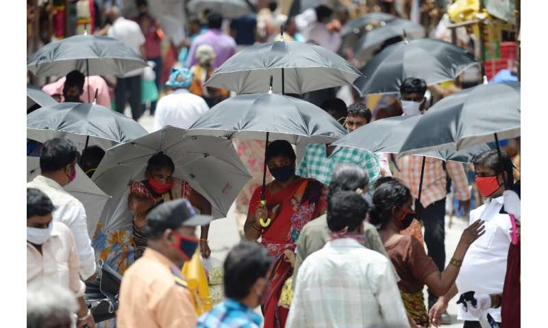 In the Indian city of Chennai, umbrellas have been distributed by volunteers to encourage social distancing