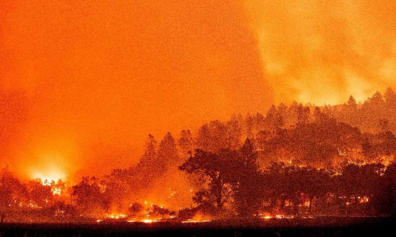 In this long exposure photograph, burning hills create a flaming landscape during the Glass fire in Napa County's St. Helena, Ca