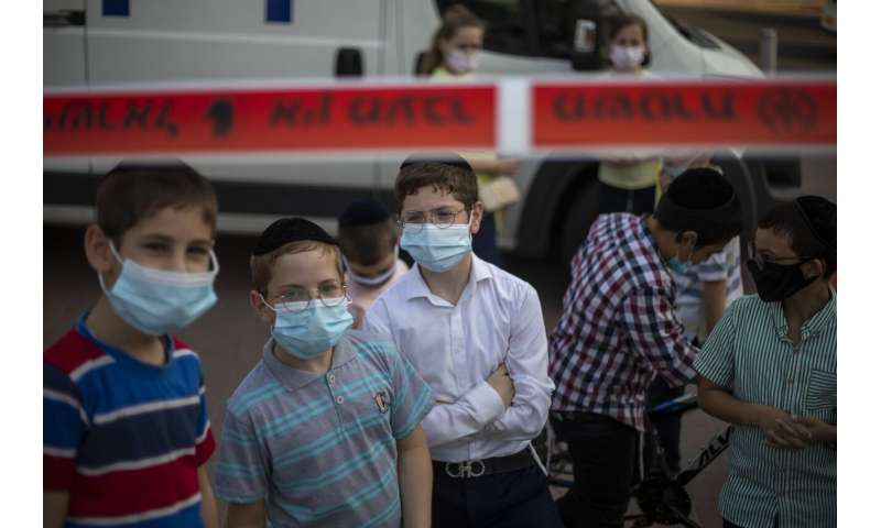 Israel imposes overnight curfews as virus deaths pass 1,000