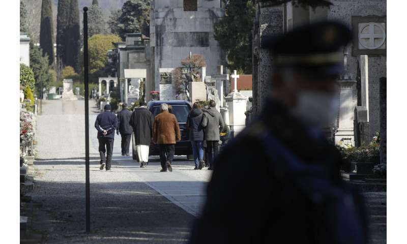Italy's virus epicenter grapples with huge toll, some hidden