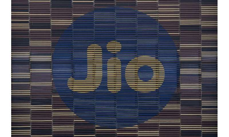 Jio's logo is seen on the front of the company's Jio World Centre in Navi, Mumbai, after Facebook said it had taken a $5.7 billi