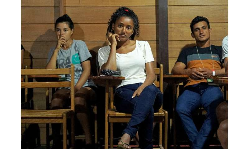 Kelita do Carmo (C) attends class as part of a program offered by the Amazonas Sustainable Foundation