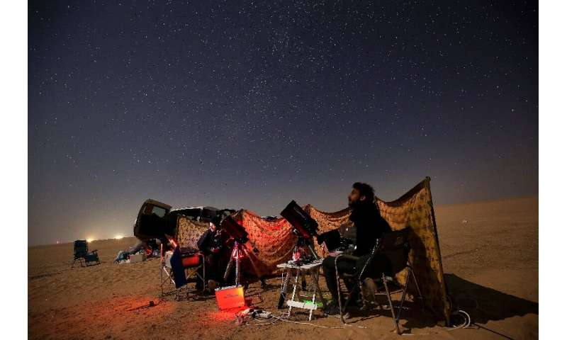 Kuwaiti astrophotographers follow the great conjunction between Jupiter and Saturn in al-Salmi district, west of Kuwait City, on