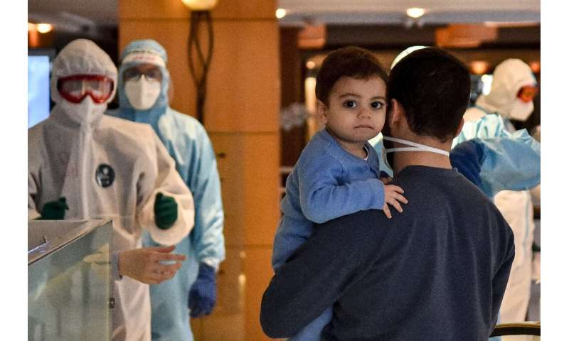 Lebanese nationals repatriated from Qatar enter quarantine at a hotel in the Lebanese capital Beirut
