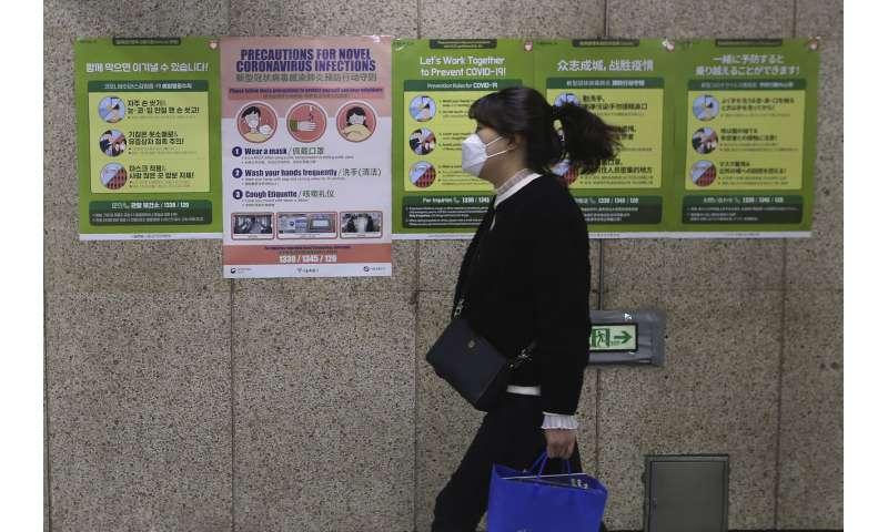 Lockdowns multiply globally as virus strains health systems