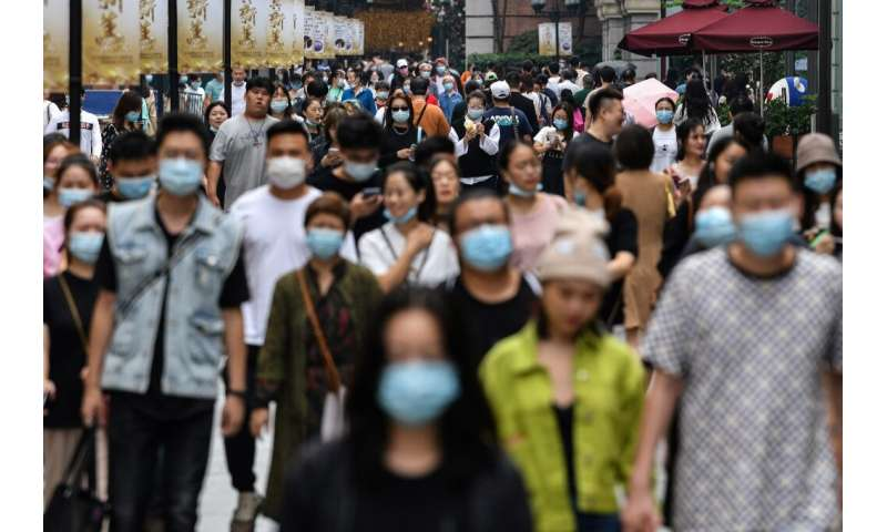 Many people in Wuhan, where the coronavirus first emerged, are still wearing masks despite there being no new cases since May