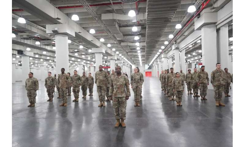 Members of the Army National Guard deploy at New York's Jacob Javits Center as New York Governor Andrew Cuomo announces plans to
