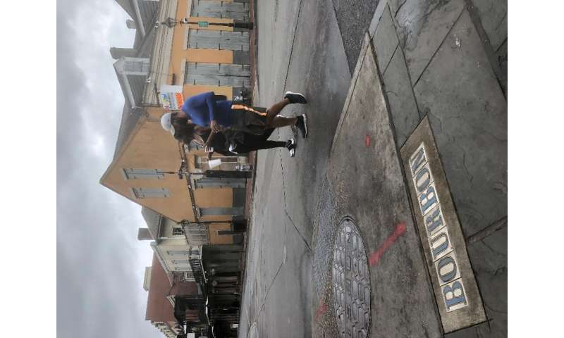 Most bars on New Orleans's Bourbon Street are closed and shuttered ahead of Hurricane Zeta's landfall