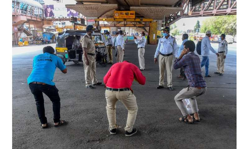 Mumbai police order people to do sit-ups as punishment for going out without a valid reason during a government-imposed nationwi