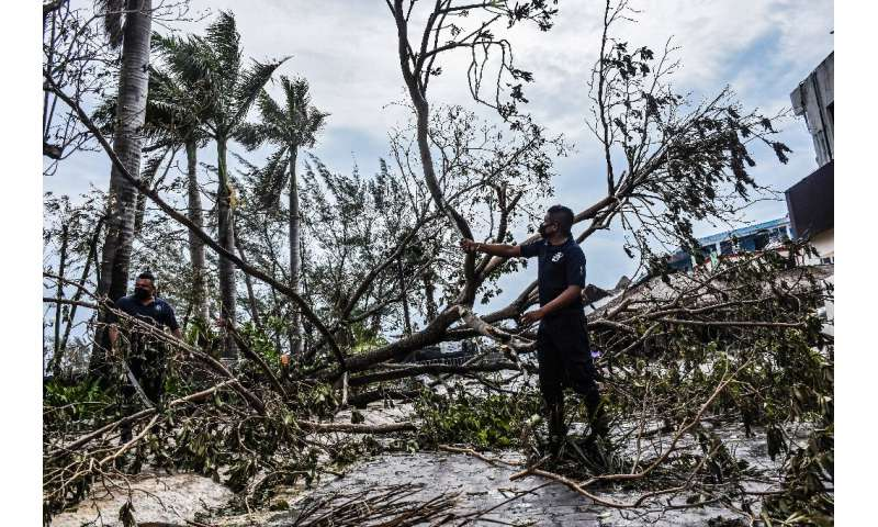 Municipal police remove fallen trees from the streets after the passage of Hurricane Zeta, in Puerto Morelos, Quintana Roo state