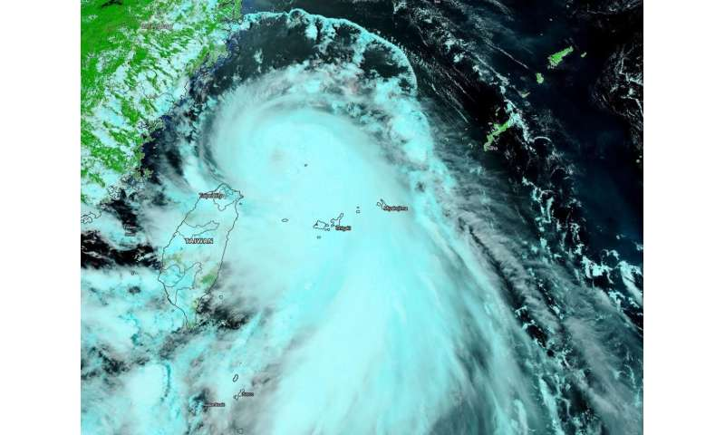 NASA finds an eye and a giant 'tail' in Typhoon Hagupit