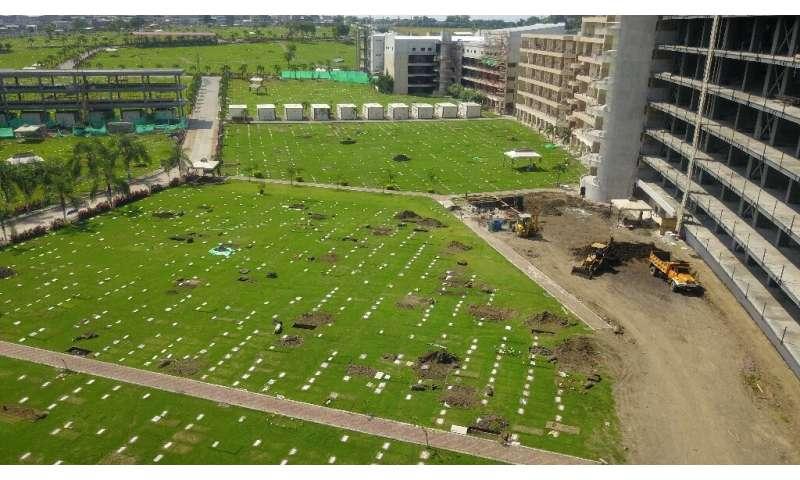 New graves at the Jardines de la Esperanza cemetery in Guayaquil, Ecuador