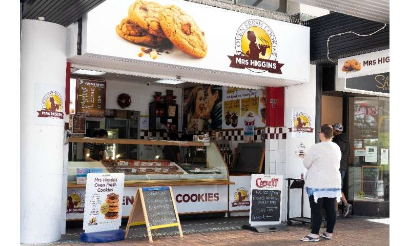 New Zealanders indulged in fast food and coffee-shop treats for the first time in five weeks as the country eased its strict loc