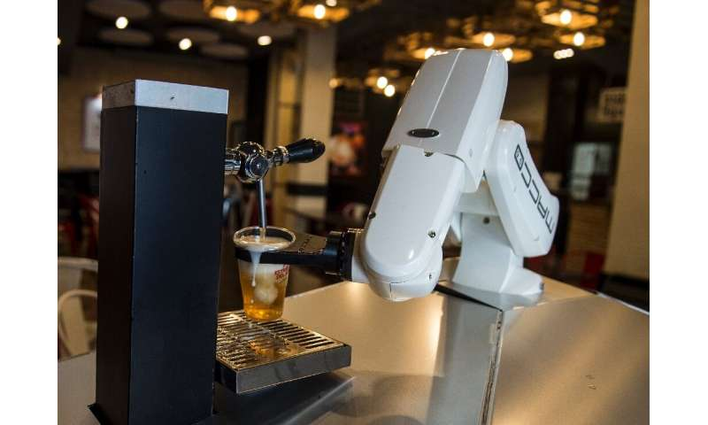 No need to tip, a robot now pulls beers at one bar in the Spanish city of Seville