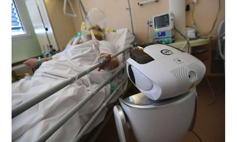 One of the six robots at the Circolo di Varese hospital in northern Italy checks up on a patient in the intensive care unit, hel