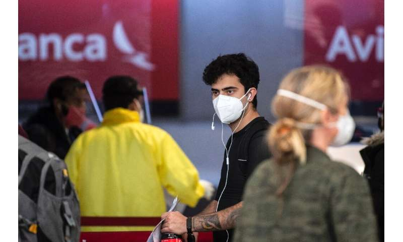 Passengers at the Avianca check-in area in Mexico City's  Benito Juarez airport International airport on May 20, 2020