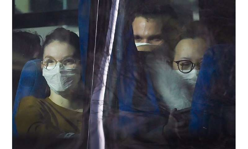 Passengers look on from a vehicle carrying French citizens evacuated from  Wuhan, China, near Marseille, France on January 31, 2