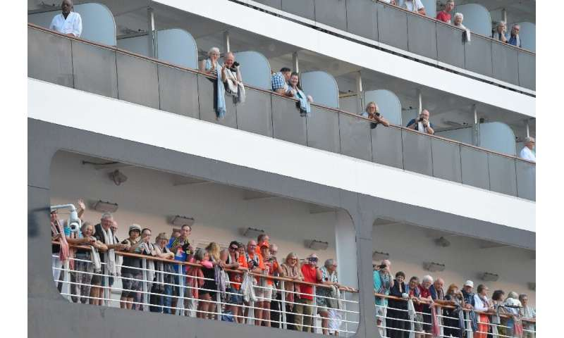 Passengers on the Westerdam cruise ship look on in Cambodia where the liner was allowed to dock after being refused entry at oth