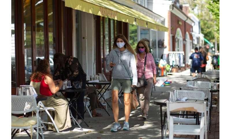 Passersby wear masks in Southampton, on Long Island, on 30 September 2020
