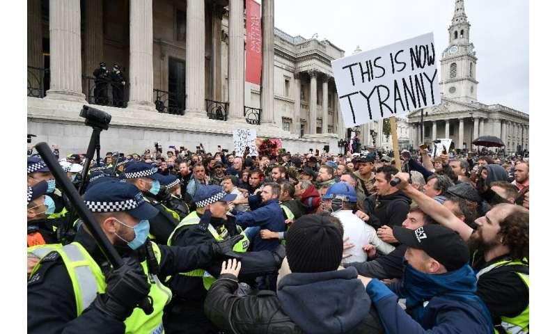 Police move in on lockdown protesters in London's Trafalgar Square