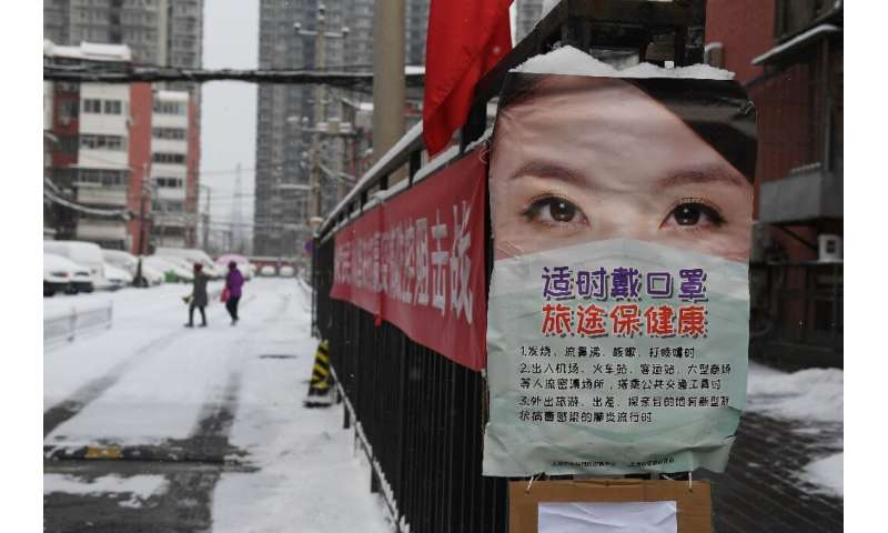 Posters warn residents in Beijing to take protective measures against the coronavirus