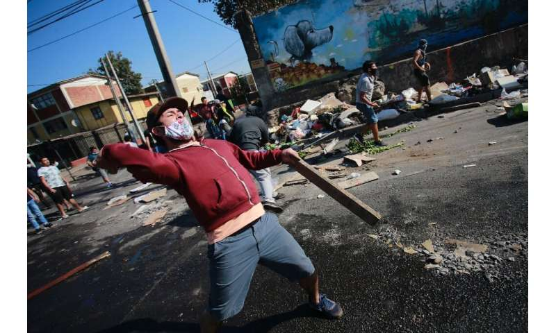Protests have gripped parts of the Chilean capital, where demonstrators are complaining of a lack of food and work because of th