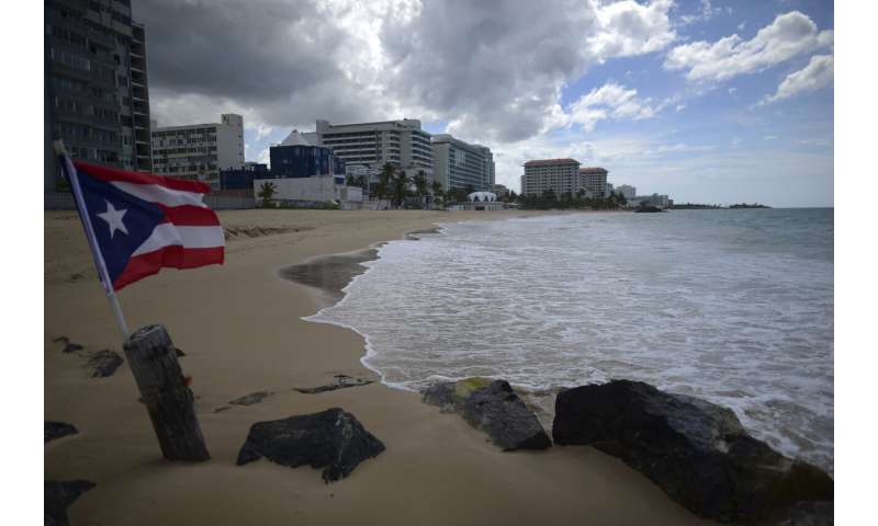 Puerto Rico claims COVID-19 peak over as concerns remain