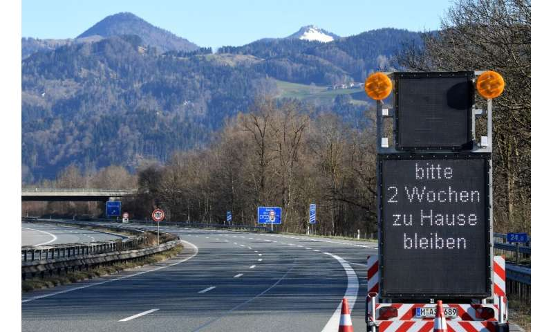 """Please stay home for two weeks,"" reads a sign on a highway near the Austrian-German border"