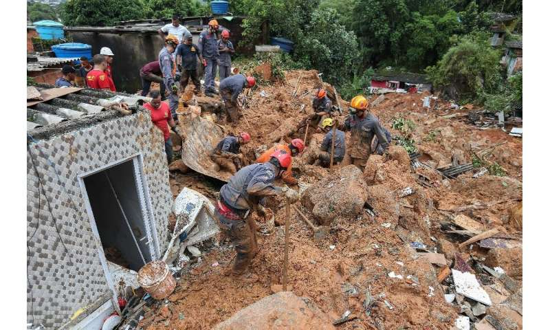 Rescuers search for victims at the Morro do Macaco Molhado favela in the coastal city of Guaruja, Sao Paulo, after it was struck