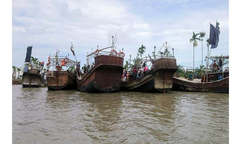 Residents from Dhalchar village being evacuated in fishing trawlers on the island of Bhola as Cyclone Amphan barrels towards Ban