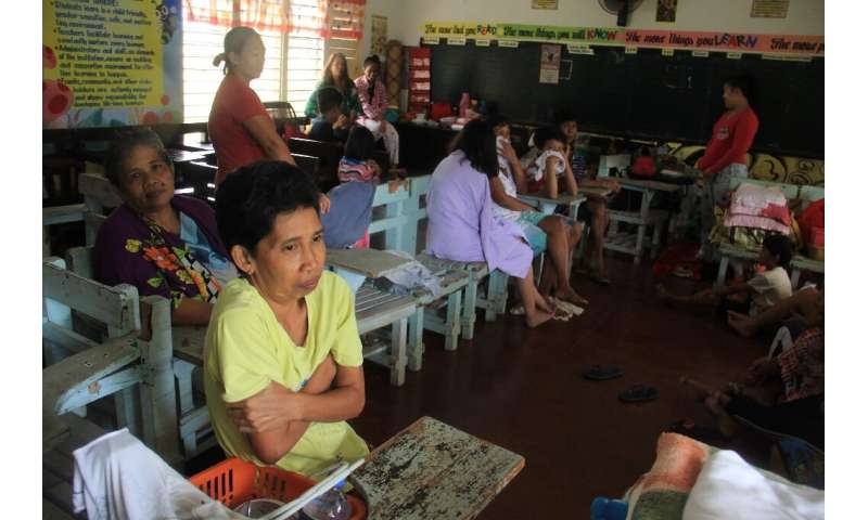 Residents shelter in a classroom used as an evacuation centre in Camalig, Albay province