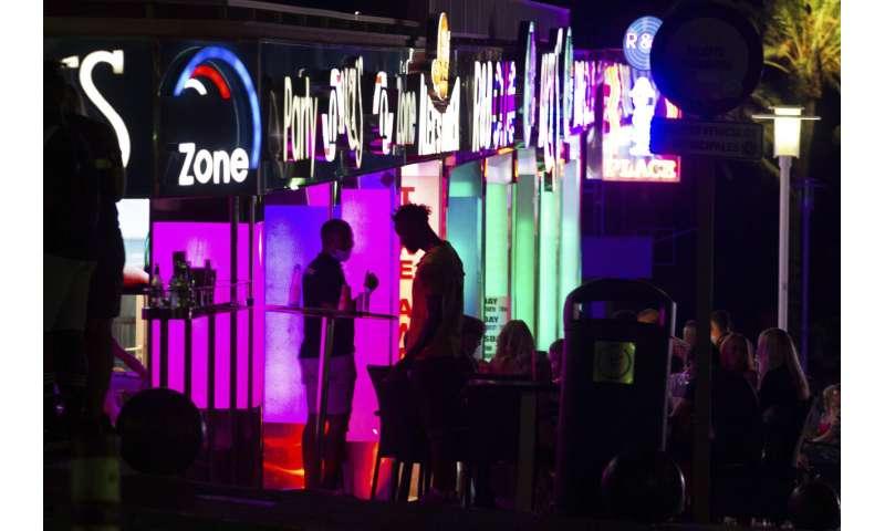 Rising virus totals force rethink of bars, schools, tourism