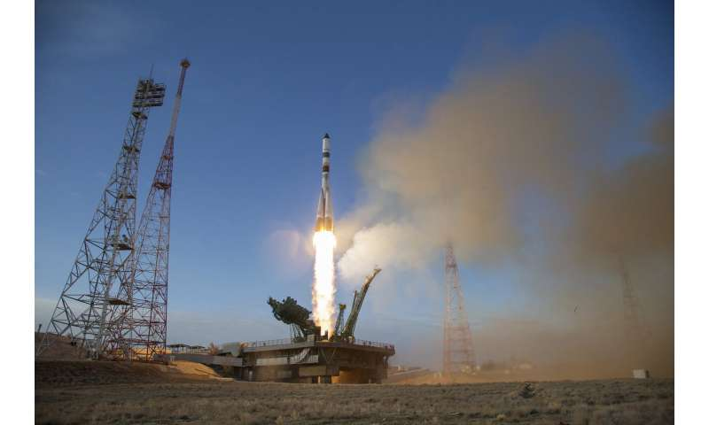 Russian cargo ship docks with space station