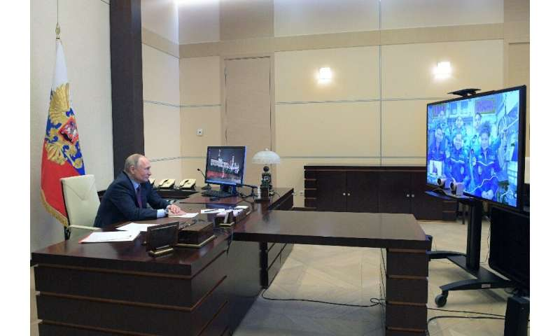 Russian President Vladimir Putin holds a video link with cosmonauts onboard the International Space Station