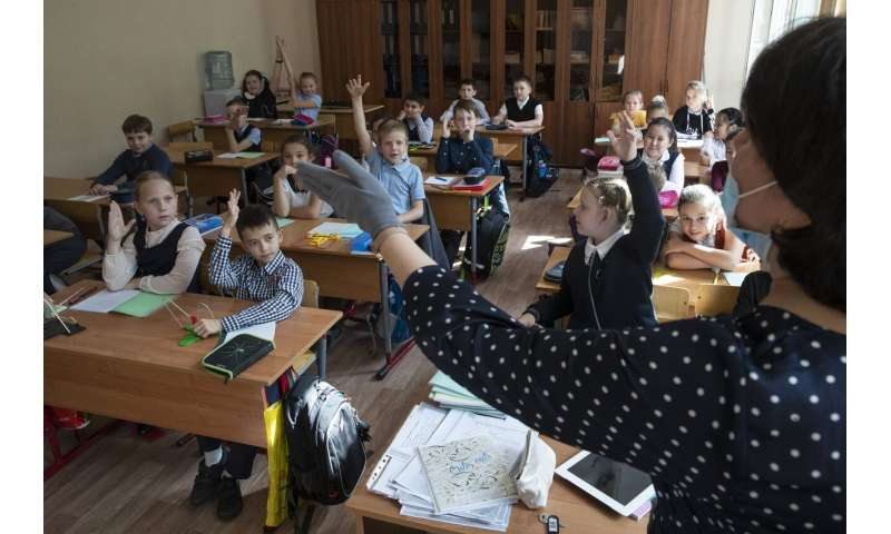 Russian schools reopen with masks, class limit precautions