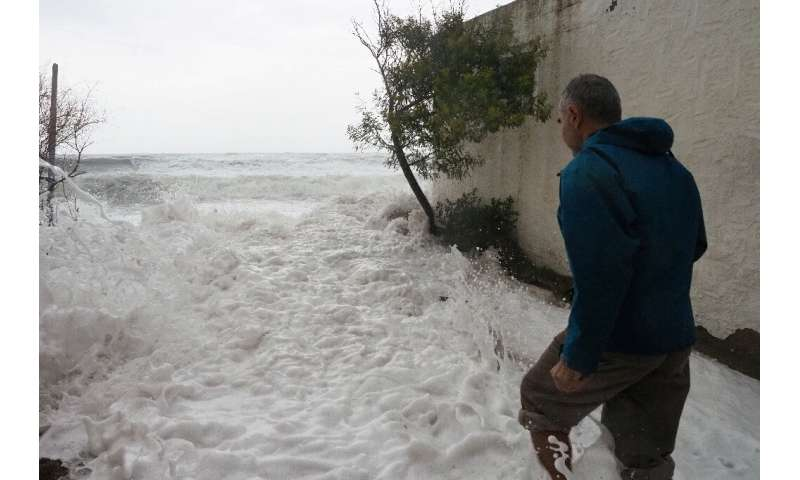 Sea water floods a street in Argeles-sur-Mer, southern France on Tuesday