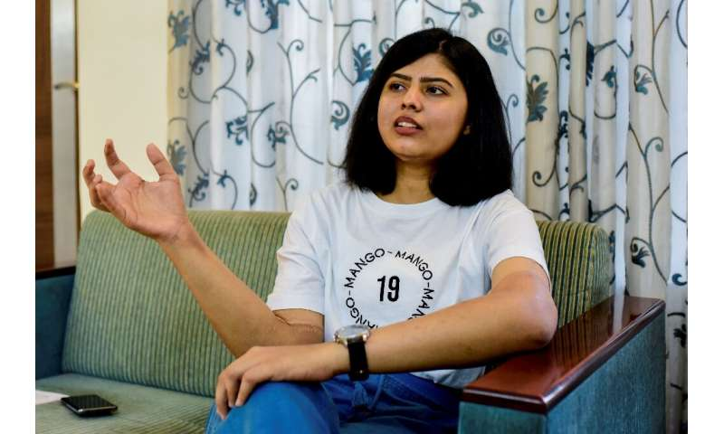 Shreya Siddanagowder gestures during an interview with AFP at her home in Pune, more than two years after she had both hands tra