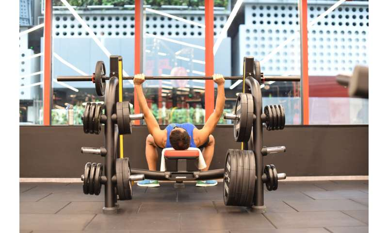 Singapore opens gyms, dining out as China outbreak steadies