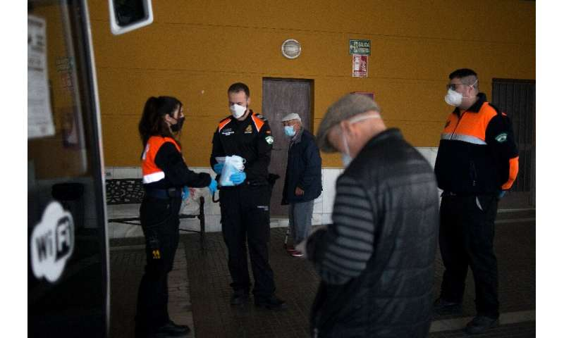 Some 4,500 police, Red Cross volunteers and security guards handed out masks at 1,500 locations across Spain