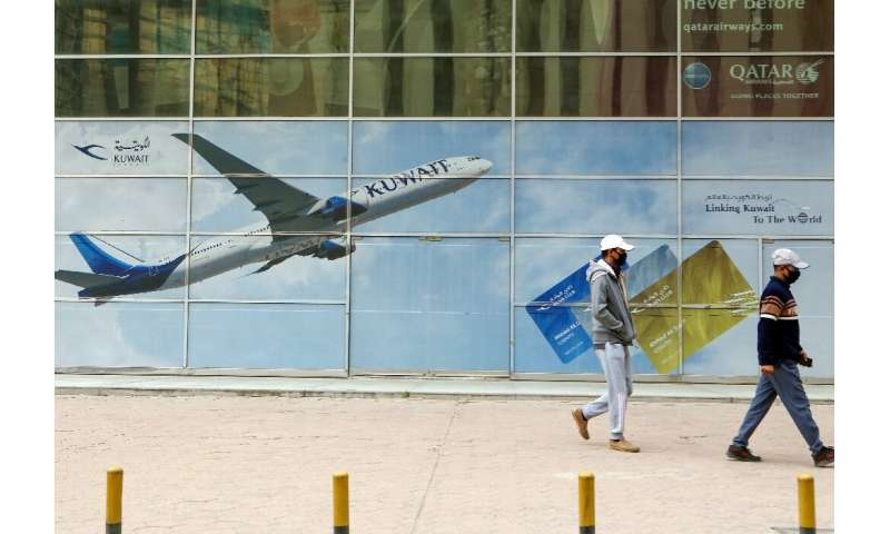 "State-owned Kuwait Airways said it will lay off 1,500 expatriate employees due to ""significant difficulties"" caused by"