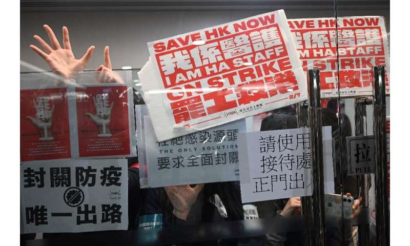 Striking medical workers demand Hong Kong close the border with China to contain the virus