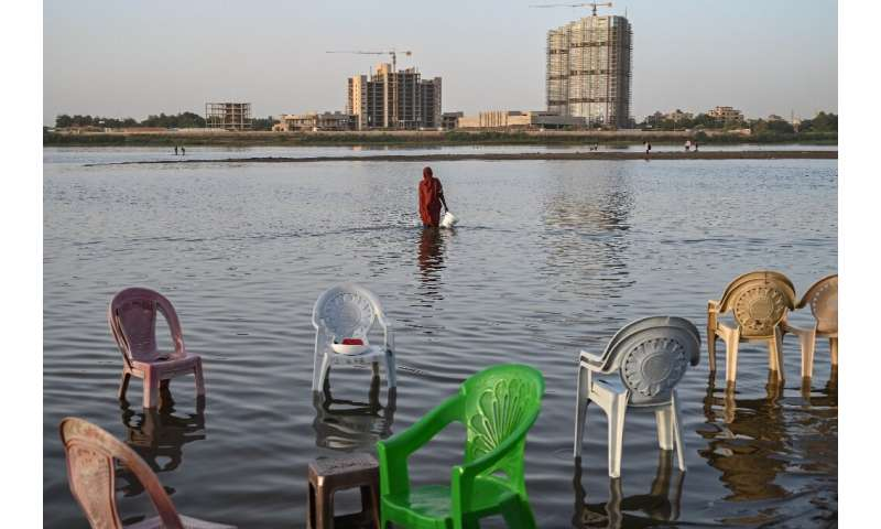 Sudan and Egypt worry the new dam's high wall will trap their essential water supplies when the giant reservoir starts to be fil