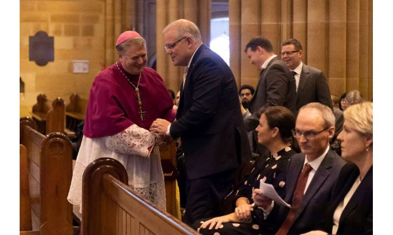 Sydney Archbishop Anthony Fisher greeting Australia Prime Minister Scott Morrison at an interfaith service in Sydney in March 20