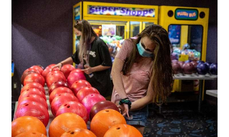 Texas was quick to begin reopening its economy—bowlers pick up clean balls at Westgate Lanes in Austin, Texas in May 2020—but th