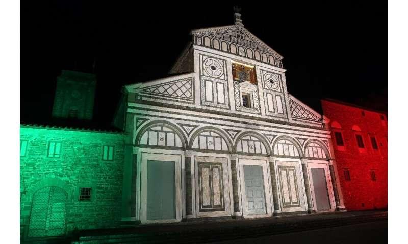 The Basilica di San Miniato al Monte illuminated with the colors of the Italian flag in Florence, Italy